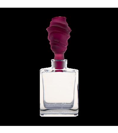 Kristian Gion tomonidan binafsharang qum parfyumining shishasi